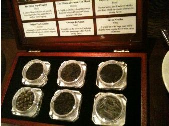 box of loose tea in jars