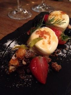White chocolate mousse with milk chocolate crumble, fresh and frozen fruits and almond praline