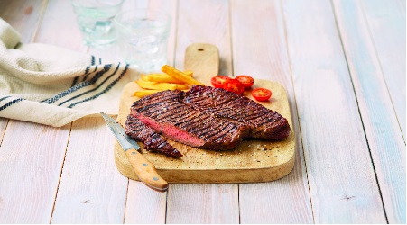 aldi steak on a board cooked to perfection
