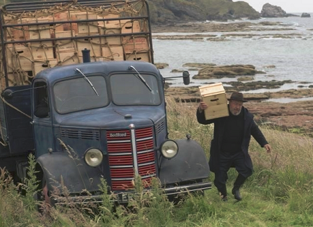 whisky van with man carrying box of whisky in Scotland