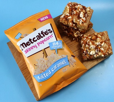 Salted caramel popcorn blondies and bag of Metcalfe's salted caramel popcorn