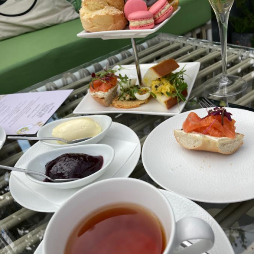 allbright afternoon tea with black tea, sandwiches, scones, jam and cream pictured